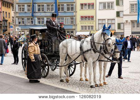 Zurich, Switzerland - 17 April, 2016: participants of children's parade (German: Kinderumzug) devoted to the upcoming Sechselauten festivity on Munsterhof square in the old town of the city. The Sechselauten is a traditional spring holiday in Zurich.