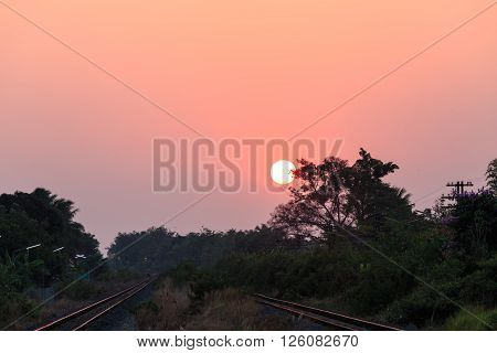 Sunset over railroad in rural of Thailand