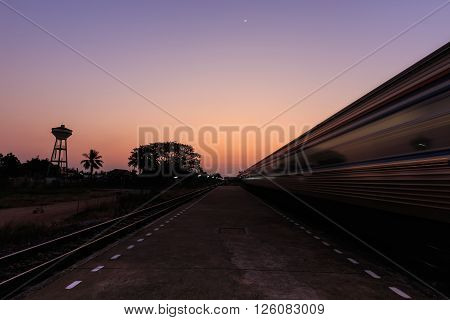 Train Moving To The Station In Sunset