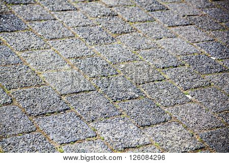 background texture from paver blocks of a road