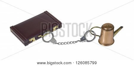 Leather briefcase attached to coffee pot via handcuffs - path included