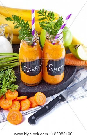 Carrot orange smoothie. Healthy lifestile. Green concept.
