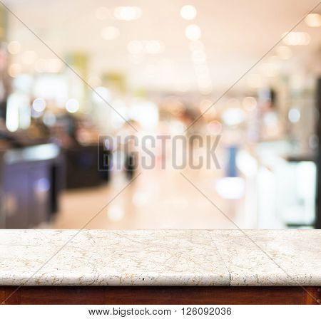 Empty marble table and blurred store in background. product display template.