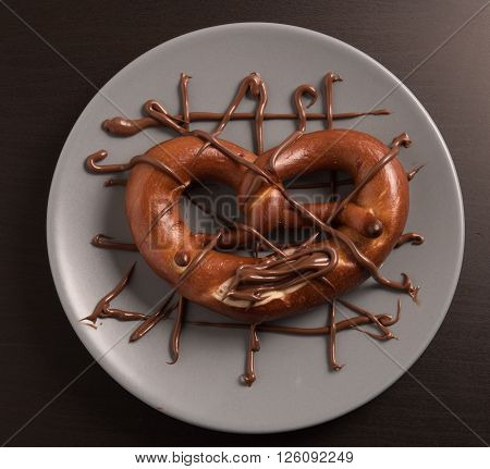 chocolate heart arrested in a blue plate