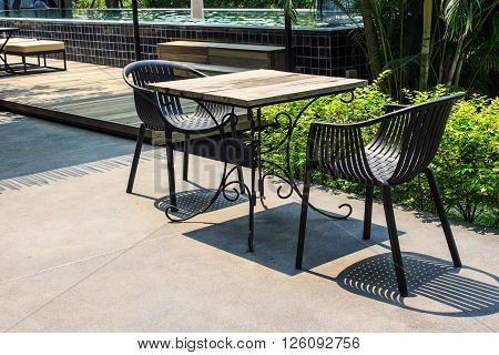 Garden furniture wood table and black chair