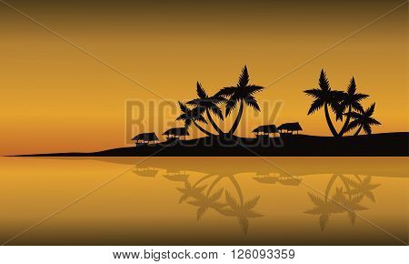Scenery beach of silhouette at sunset with gazebo and palm