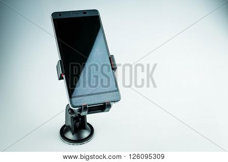 Car holder for mobile device on white background