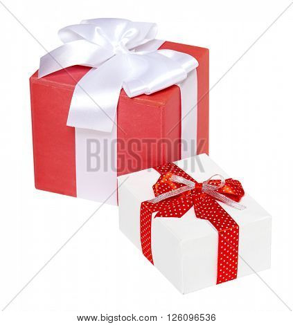 two gift box decorated silk red ribbon and bow, object on white studio background isolated