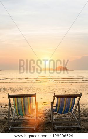Sun loungers on the beach during sunset.