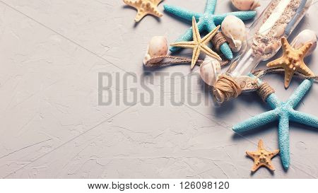 Marine items on grey tetured slate background. Sea objects. Selective focus. Place for text. Toned image.