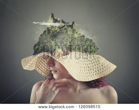 Beautiful girl wearing a hat with a island situated in top of the hat