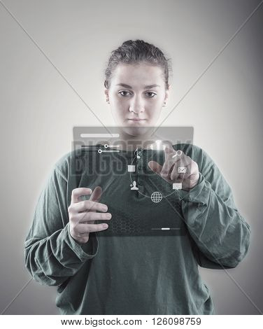 Young girl using virtual screen; checking database and identity on high tech technology