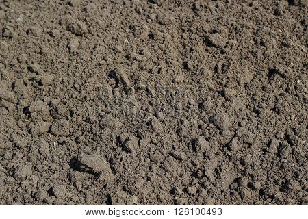 Tilled brown ground  background at  Croft. Spring