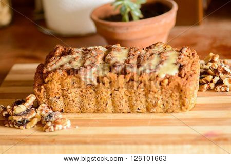 Carrot and orange vegan cake with nuts and vegan condensed milk