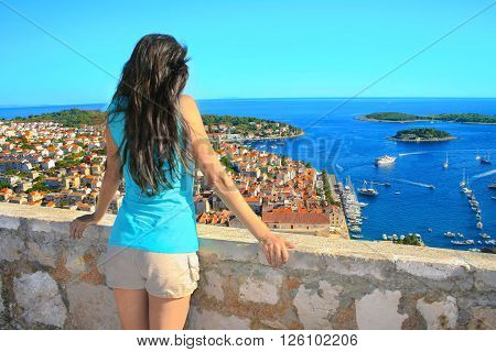 Young woman enjoying the view on Croatian island Hvar.
