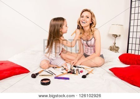 Cute Little Girl Helping Her Mother With Makeup