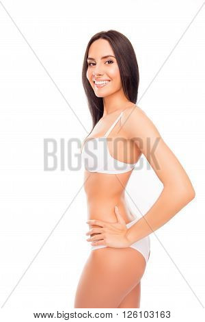 Side View Photo Of Cheerful Smiling Young Woman In White Lingerie