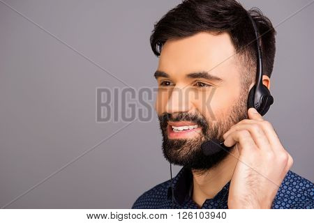Portrait Of Cheerful Man In Head-phones Touching Microphone
