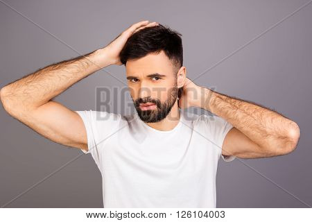 Portrait Of Young Bearded Man Expertising His Hair