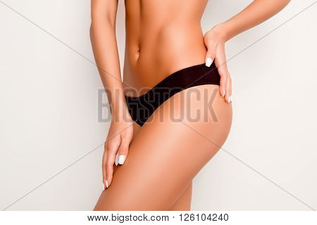 Beautiful Slim Woman Body With Tan Isolated On White Background