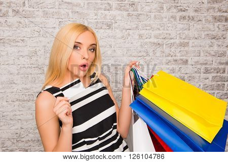 Portrait Of Attractive Shopper Holding Bank Card And Packs With Clothes
