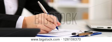 Hand Of Businesswoman Filling And Signing