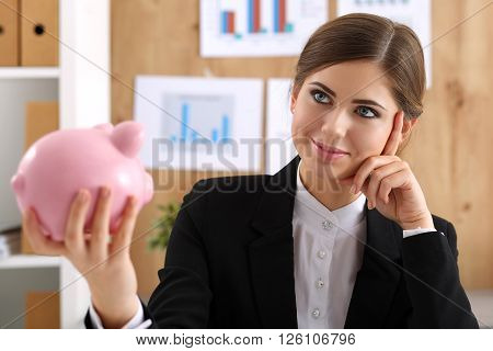 Happy Mysterious Beautiful Woman Hold Funny Piggybank