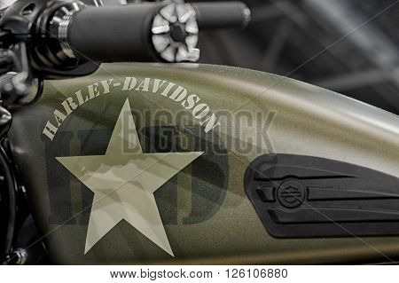 BRNO, CZECH REPUBLIC-MARCH 4,2016: Close up army style fuel tank of motorcycle Harley Davidson Softail Slim S on International Fair for Motorcycles on March 4,2016 in Brno in Czech Republic