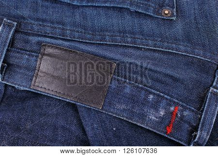 jeans closeup with blank leather label for your text