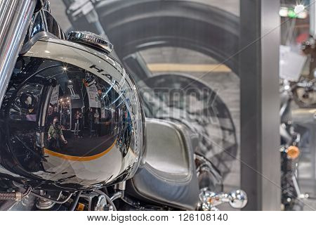 BRNO, CZECH REPUBLIC-MARCH 4,2016: Close up fuel tank of motorcycle Harley Davidson Dyna Fat Bob with reflection of visitors on International Fair for Motorcycles on March 4,2016 in Brno in Czech Republic