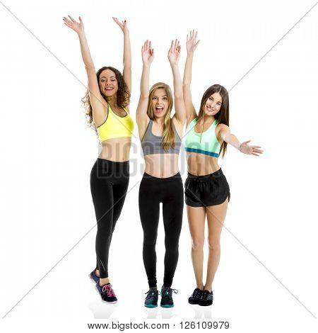 Three beautiful and athletic girls in studio