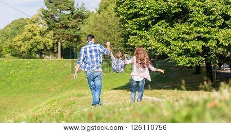 Family having walk holding hands