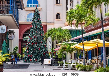 Port Louis Mauritius - December 25 2015: Christmas tree in the tropics on the waterfront of Port Louis capital of Mauritius. It is a perfect Shopping Mall to have a walk and enjoy Christmas Holidays.