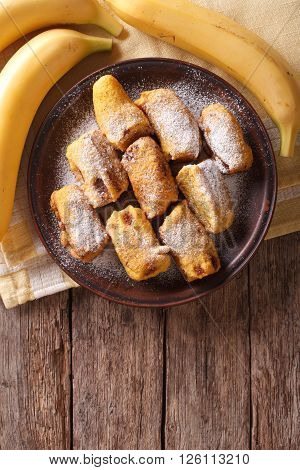 Fried Bananas In Batter On A Plate. Vertical Top View