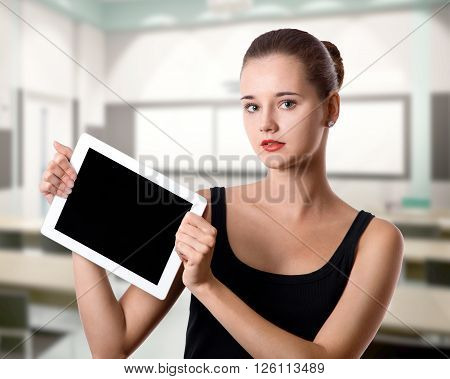 Young Woman Holding A Tablet Computer