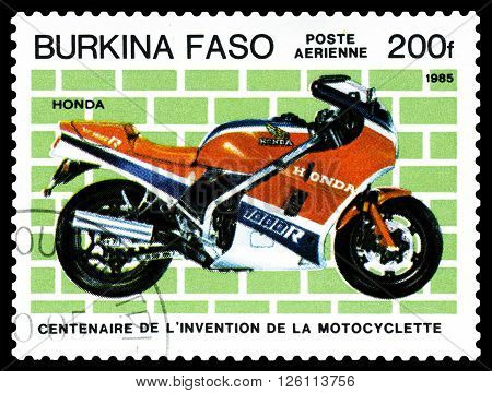 STAVROPOL RUSSIA - MARCH 16 2016: a stamp printed in Burkina Faso shows an old motorcycle Honda stamp devoted to the centenary of the invention of motorcycle circa 1985