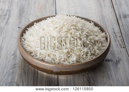 cooked white rice in a bowl, plain basmati rice, cooked basmati rice in ceramic bowl