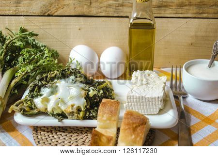 The shoots of spring edible grass with eggs and sheep cheese