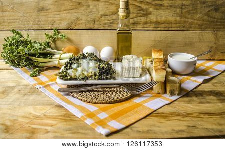 Sheep cheese with Is tucked  eggs shoots of edible spring grass