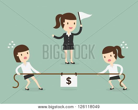 Business women in a tug-of-war. competition concept
