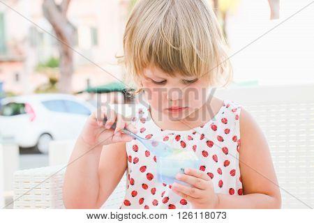 Cute Baby Girl Eats Frozen Yogurt With Ice Cream