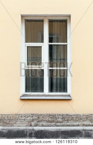 Yellow Wall And Window In White Frame