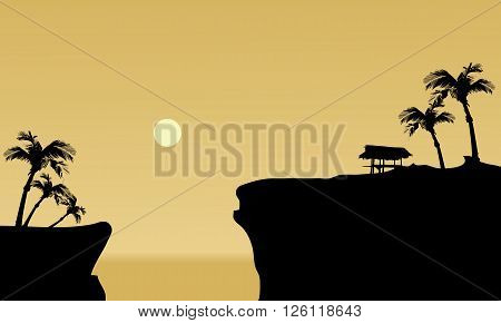 Silhouette of gazebo in cliff with moon