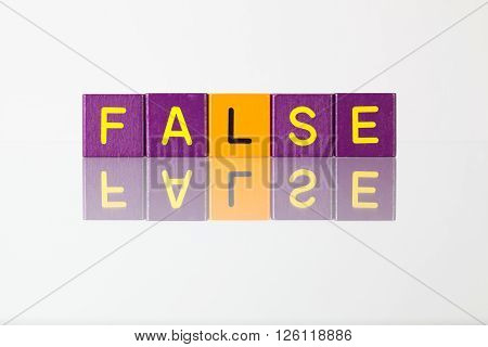 False - an inscription from children's wooden blocks