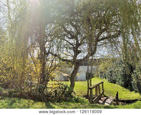 little bridge in a greenery rural garden
