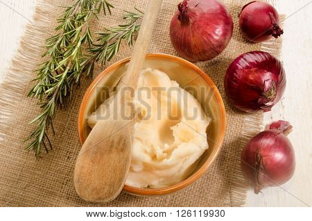 home made lard in a bowl lilac onion rosemary on jute