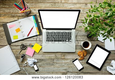 Laptop with other modern electonic devices on desk