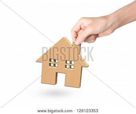 Woman Hand Picking Wooden House