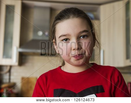 Concerned girl in the interior of her room