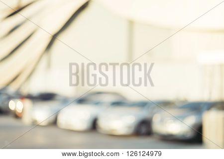 Blurred background - Car park outdoor with bokeh. Vintage filtered image.